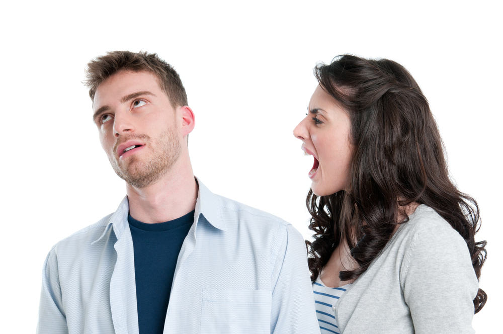 Young couple in conflict shouting isolated on white background
